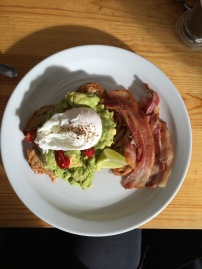 Avocado Poached Egg with Bacon for breakfast at The Breakfast Club in London