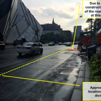 Just east of the Bloor & Avenue Road intersection. This shows how much space is reduced on the road due to the construction.