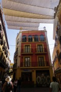 To deal with the heat the cities inhabitants had installed awning clothbetween buildings to provide shade